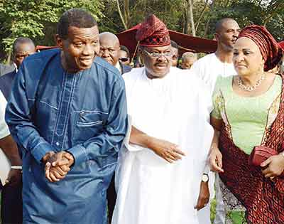 General Overseer, Redeemed Christian Church of God (RCCG), Pastor Enoch Adeboye (left); Oyo State Governor, Senator Abiola Ajimobi and his wife, Florence, during the state's Christmas Carol and thanksgiving service, held at Agodi Gardens, Ibadan... at the weekend.                                 PHOTO: OYO STATE GOVERNMENT