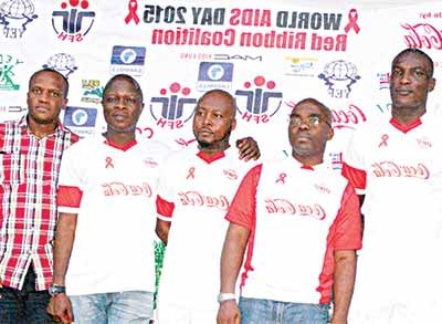 Former Super Eagles star, Victor Agali (left); Director, Public Affairs & Communication, Coca-Cola Nigeria Limited, Clem Ugorji; retired international, Ifeanyi Udeze; HIV/AIDS Specialist, Society for Family Health Lagos (SFH), Emmanuel Olaoti and National Convener 2015 Nigerian Red Ribbon Coalition and Community Affairs Manager, Coca-Cola Nigeria Limited, Emeka Mba; during the World AIDS Day Novelty Football Match organized by the Nigerian Red Ribbon Coalition in Lagos…at the weekend.
