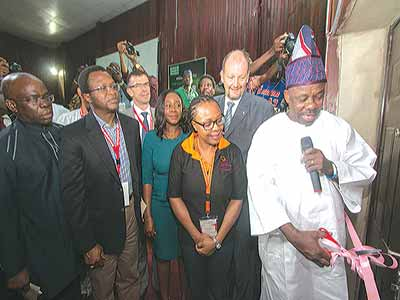 Ogun State governor, Senator Ibikunle Amosun (cutting the tape) for the opening ceremony of Ake Arts and Book Festival; European Union Ambassador, Mr. Arrion Michel (left); Director, Ake Arts and Book Festival, Lola Shoneyin; Manager, Sponsorship and High Value Event, Etisalat, Opeyemi Lawal; Chief Financial Officer, Marine Platforms Limited, Mr. Baji Nyam and an official… in Abeokuta