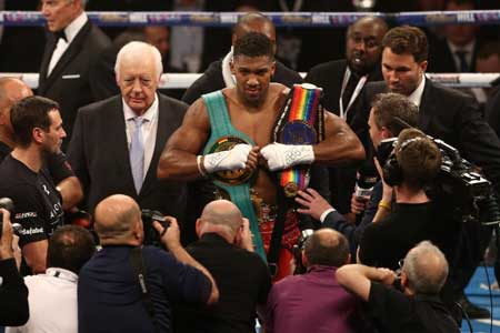 Anthony Joshua celebrates beating Dillian Whyte in the British and Commonwealth heavyweight title match at the O2 arena in London on December 12, 2015 (AFP Photo/Justin Tallis)