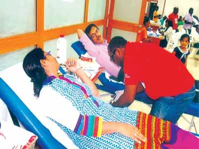 Kewalram directors donating blood at the camp