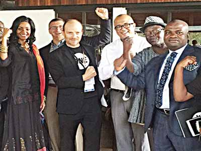Bono (second left) with AFRIMA Team in Accra, Ghana.