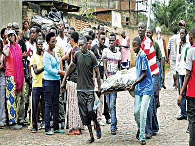 Burundi photo caption: Men carry away a body in the Nyakabiga neighbourhood of Bujumbura, Burundi on Saturday [AP Photo]