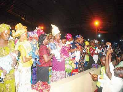 "Chosen mothers with their babies, during the dedication at the just concluded two-day crusade: ""Hope For The Needy,"" held at the Chosen ground in Ijesha, Lagos."