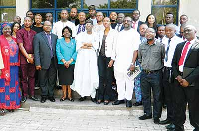 Minister of Information and Culture, Alhaji Lai Mohammed (M); Permanent Secretary, Mrs Ayo Adesugba (5th left);Representatives of Civil Society Groups, Mr Clement Nwankwo (4th left), and other members of the Civil Society Organisations, (CSO) after a meeting of the minister with CSO in Abuja