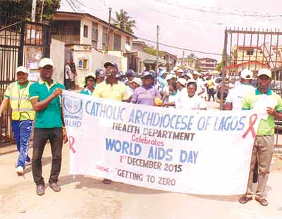 Participants at the walk, awareness and sensitization rally with free tests organized by the Catholic Archdiocese of Lagos Heath Department (CALHD) through St John the Evangelist Catholic Church 2 Wuraola Street, Ladipo-Shogunle to end Human Immuno-deficiency Virus (HIV)/Acquired Immune Deficiency Syndrome (AIDS) mark 2015 World AIDS Day                                     PHOTO; VICTOR NWOSU