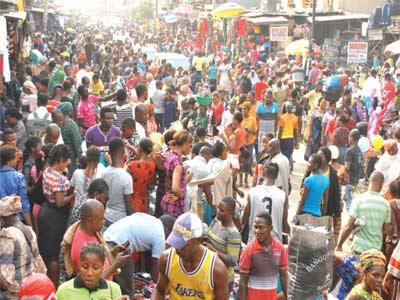 Shoppers at Post Office Road, Oshodi, Lagos Yesterday ...PHOTO: AYODELE ADENIRAN