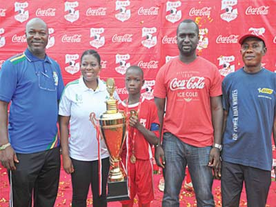 Chairman, Technical Committee, Lagos Football Association, Mr. Dotun Coker; National Secretary, Nigerian School Sports Federation (NSSF), Olabisi Joseph; Team Captain, winners of the 2015 Copa Coca-Cola, Awori College, Ojo, Fasasi Elijah; Senior Brand Manager, Colas, Coca-Cola Nigeria Limited, Gbolahan Sanni, and Principal, Awori College, Ojo, Adeyemo Joshua, at the COPA Coca-Cola finals, held at Dairy Farm Secondary School, Lagos...recently.