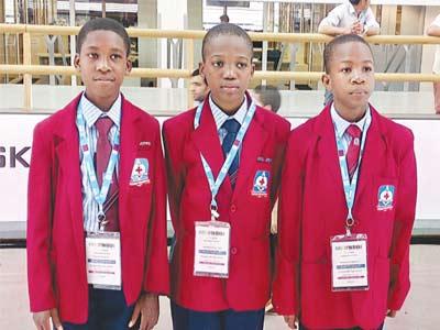 Pupils of Deeper Life High School Port Harcourt, Oluyoye Daniel (left); Nnaemeka Chukwuebuka and Ogbonna Chibuoyim at the World Robot Olympiad event in Qatar.