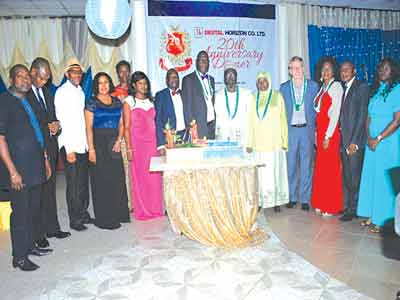 The Managing Director, Digital Horizons, Akhigbe Klein Irenen (Centre), Prince Ebenezer Oluseyi Lufadeju, a town planner and other guest during the 20th anniversary celebration in PortHarcourt, Rivers State, recently
