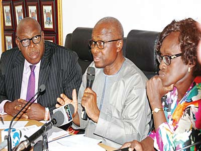 Special adviser on primary health care, Lagos state, Dr. Olufemi Onanuga(left); Commissioner for health, Lagos, Dr Jide Idris; Permanent secretary, Ministry of Health, Lagos, Dr Modele Osunkiyesi at the ministry press briefing in lagos yesterday. PHOTO; SUNDAY AKINLOLU