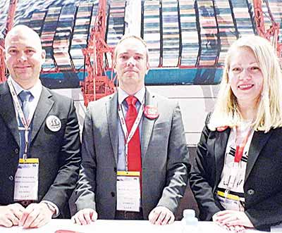 Karmar's Sales Director in charge of solution and marketing, Joun Kyllonen (Left); Product Manager in charge of Horizontal Transportation, Henrik Haggblom and Vice President (Marketing and Communications); Maija Ekiof at the just concluded 2015 Container Conference in Dubai, United Arab Emirates.