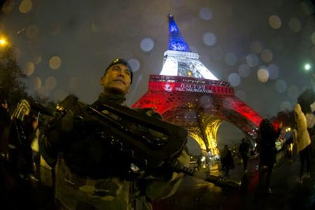 A French soldier on guard at the Eiffel Tower in Paris, following a terror attack that left 130 people dead in the capital city on November 13, 2015 PHOTO: AFP