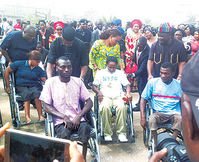 Benue State Governor Samuel Ortom (right), wife, Mrs. Eunice Ortom, (behind the wheelchair of a youth corps member) and other government officials with physically challenged persons during World Disability Day held at Government House, Makurdi…yesterday
