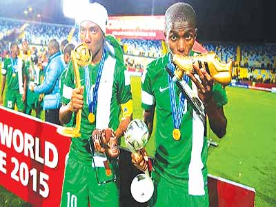 PHOTO: Golden Eaglets after winning the World Cup in Chile				                     PHOTO: AFP