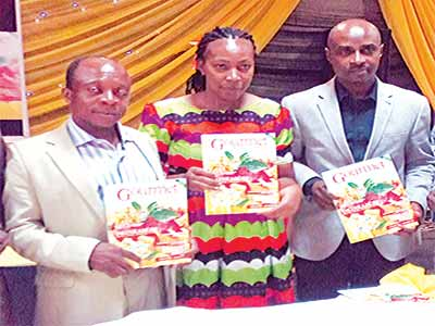 Special Adviser to the former Minister of Agriculture, Dr. Akinwumi Adesina, Dr. Olukayode Oyeleye (left); Publisher The Gourmet Magazine, Mma Lydia Louis Eke; News Editor of Channels Television, Louis Eke at the launch of The Gourmet Magazine in Lago               PHOTO: JEMINOYO AMUKA