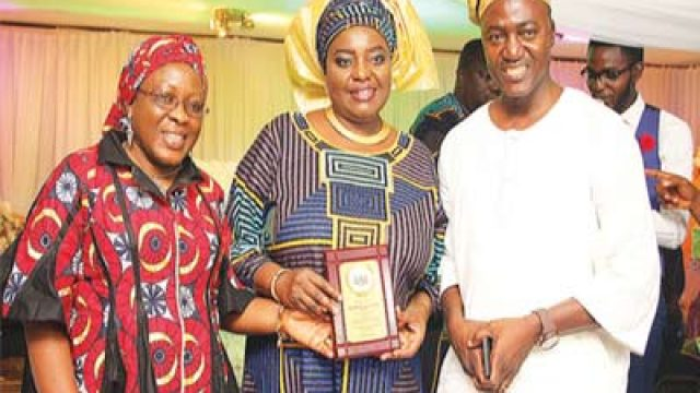 Administrator of Grace Schools, Mrs. Tokunbo Edun (middle) with two of the parents.