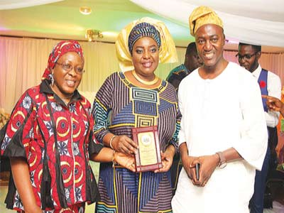 Administrator of Grace Schools, Mrs. Tokunbo Edun (middle) with two of the parents who won awards, Mr. and Mrs. Bello Abdulkadir, at the event.