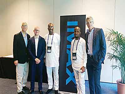 Managing Director of Film House Cinema and Film One Distribution company, Mr. Kene Mkparu and IMAX officials at the signing ceremony… in Lagos
