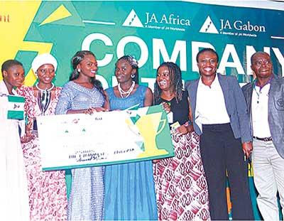 Team Dynamites, winners of the 2014 Company of the Year Africa award, Mercy Idoko (left); Maryam Gambo Zakari; Monalisa Uyojo Ogbobi; Faith Ichado, JAN, Abuja Programmes Officer Saratu Bijimi; Executive Director, JAN, Efua Edeh; and Chaperone/Teacher Government Girls College, Abuja, Ojoh Francis Egbunu, at the event.