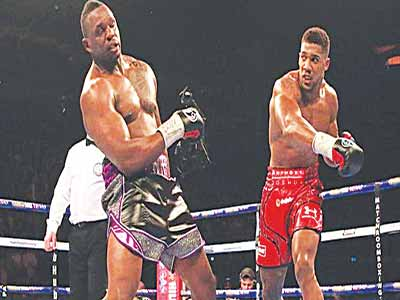 British heavyweight champion, Anthony Joshua (right) knocked out Whyte in the seventh round.