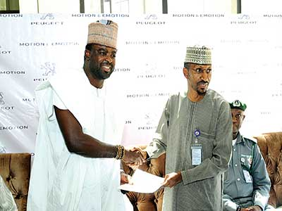 MD PAN Nigeria Mr. Ibrahim Boyi (right) in hand shake with Kunle Ofolayan after the official signing of an MoU for The CEO, during the unveiling of the new Peugeot 508, 2016 model in Abuja.