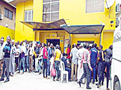 MTN subscribers in one of the service centres' in Lagos, queuing to re-register their lines. This formed one of the high points of the sector in 2015.