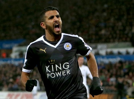 Leicester City's midfielder Riyad Mahrez celebrates after scoring his third goal during an English Premier League football match against Swansea City on December 5, 2015 PHOTO: AFP
