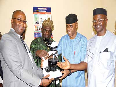 General Manager, Technical Geosciences, ExxonMobil, Mr. Mike Udoh (left), Paramount Ruler of Ikot Akpaden, Edidem Akpan Akpan Ekpene, Vice Chancellor, Akwa Ibom State University, Prof. Eno James Ibanga and the Special Adviser to the Akwa Ibom State Governor on Education Monitoring, Mr. Udeme Isaac Udofia, during the official opening of a N300m geosciences workroom donated to the university by ExxonMobil.