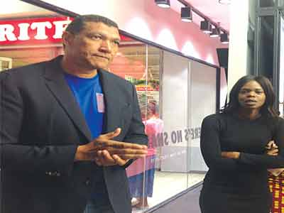 NIKE's Mike Brown (left) and Jumoke Adekunle explaining the features of the kit maker's new shop at the Lekki Mall, Lagos…at the weekend.