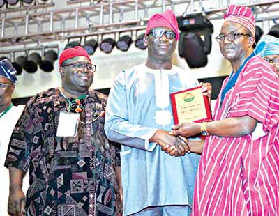Executive Director, PPP Resources, , Infrastructure Concession Regulatory Commission, Mr. Chudi Izuwah. MD, Alpha Mead Facilities & Management Services Ltd, Femi Akintunde, and, President, The Nigerian Society of Engineers (NSE) Ademola Olorunfemi, during the presentation of the Award to Akintunde at the National Conference of the NSE in Akure…recently