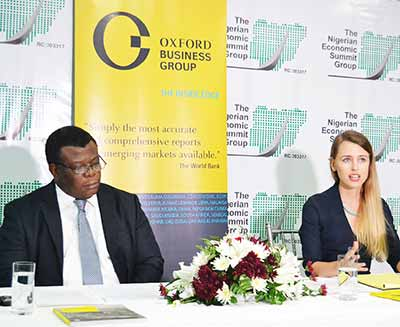 Country Director, Oxford Business Group, Izabela Kruk (right); and the Chief Executive Officer, Nigeria Economic Summit Group (NESG), Laoye Jaiyeola, during the signing of a memorandum of understanding between NESG and OBG, in Lagos.