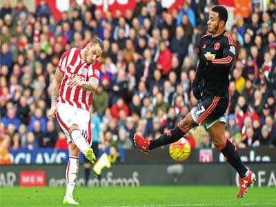 Stoke City's Austrian striker Marko Arnautovic (left) shoots past Manchester United's Dutch midfielder Memphis Depay to score their second goal during the Premiership match at the Britannia Stadium in Stoke-on-Trent, yesterday. PHOTO: AFP / PAUL ELLIS