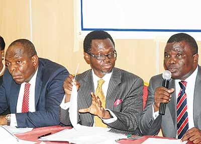 Secretary, TrustBond Mortgage Bank plc, Mark Okoye (left); Managing Director, Adeniyi Akinlusi and Chairman, Etigwe Uwa at the yearly general meeting of the company in Lagos, recently                         PHOTO: SUNDAY AKINLOLU