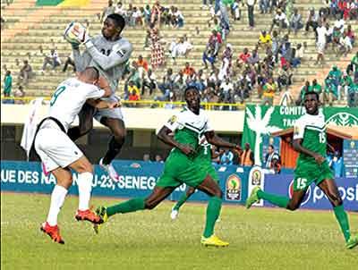 U-23 Eagles' Goalkeeper Emmanuel Daniel stops a goal-bound move... yesterday.                      PHOTO: SUPERSPORTS