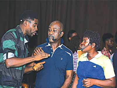 Patrick Diabuah and Bimbo Manuel and another cast member during rehearsals for Wakaa