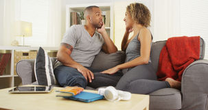 african-american-couple-talking-together-couch-home-47557946