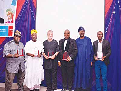 Group Publisher/Editor-in-Chief Brand Age Magazine, David Adesola Adeyemi, renowned Communication Scholar, Prof Idowu Sobowale, CEO CPMS Africa Mr. Chris Parkes, CEO Verdant Zeal Group, Olatunji Joshua Olugbode, Chairman of the Occasion, Sir Demola Aladekomo and Mr Kola Omisore during the Grand Investiture Dinner Organised by Babba and Ruby ventures LTD in Honour of Dr. Olatunji Joshua