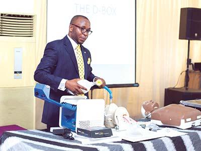 Olakulehin demonstrating how D-Box works