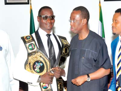 African Heavyweight Wrestling Champion (left), Power Lee, Chairman, Delta State Sports Council, Tony Okowa and CEO/MD Silec Entertainment Concept, Sunny Irakpo, when the wrestler's team visited the sports administrator…recently.