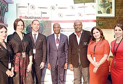 Chief Executive Officer, Nigerian Stock Exchange (NSE) (middle); and Chief Executive Officer of Pan African International Group, Iyke Ejizu; and other members of The Business Year (TBY) team, after the launch of the second edition of TBY, in Davos, Switzerland.