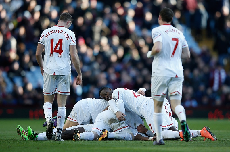 Liverpool's Ivorian defender Kolo Toure is mobbed by teammates as they celebrate him scoring the team's sixth goal during the English Premier League football match between Aston Villa and Liverpool at Villa Park in Birmingham, central England on February 14, 2016. / AFP / ADRIAN DENNIS / RESTRICTED TO EDITORIAL USE. No use with unauthorized audio, video, data, fixture lists, club/league logos or 'live' services. Online in-match use limited to 75 images, no video emulation. No use in betting, games or single club/league/player publications. /