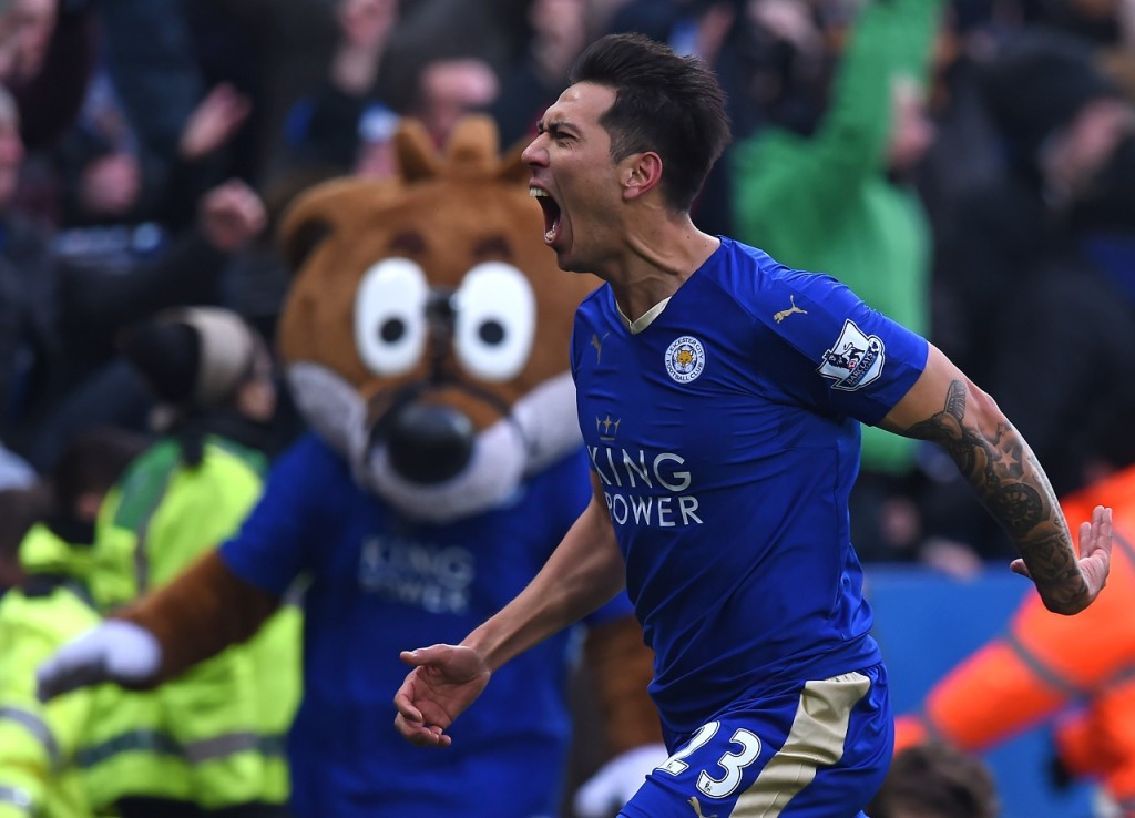 Leicester City's Argentinian striker Leonardo Ulloa celebrates scoring the opening goal of the English Premier League football match between Leicester City and Norwich City at King Power Stadium in Leicester, central England on February 27, 2016. Leicester won the game 1-0. / AFP / Paul ELLIS / RESTRICTED TO EDITORIAL USE. No use with unauthorized audio, video, data, fixture lists, club/league logos or 'live' services. Online in-match use limited to 75 images, no video emulation. No use in betting, games or single club/league/player publications. /