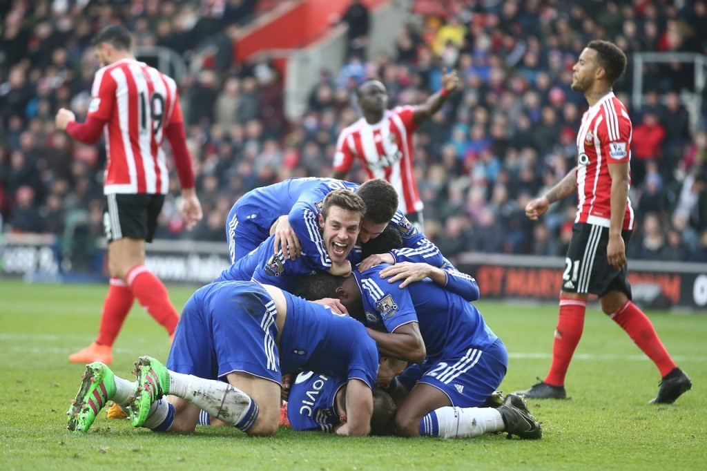 Chelsea players celebrate after their Serbian defender Branislav Ivanovic (floor) headed in their second goal during the English Premier League football match between Southampton and Chelsea at St Mary's Stadium in Southampton, southern England on February 27, 2016. / AFP / JUSTIN TALLIS / RESTRICTED TO EDITORIAL USE. No use with unauthorized audio, video, data, fixture lists, club/league logos or 'live' services. Online in-match use limited to 75 images, no video emulation. No use in betting, games or single club/league/player publications. /