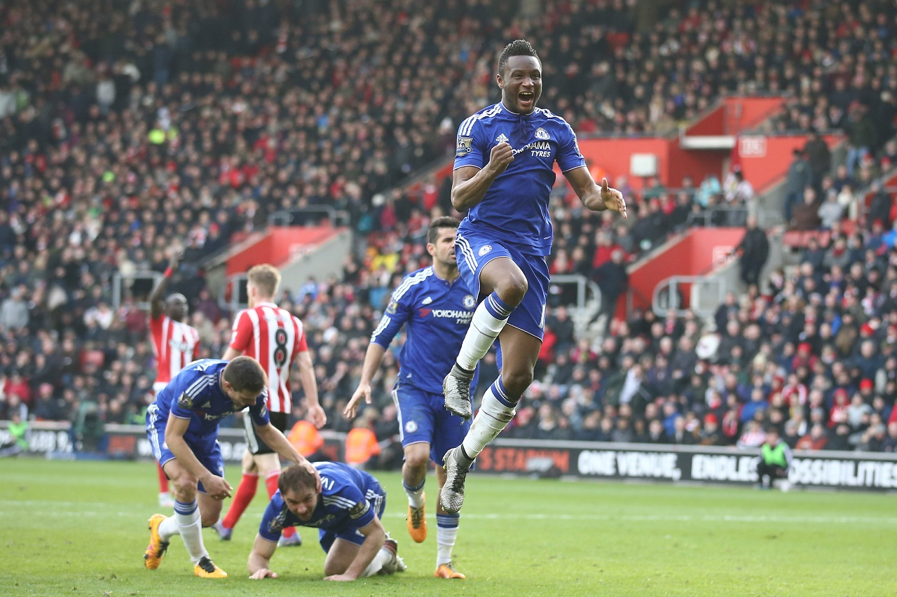 Chelsea's Nigerian midfielder John Obi Mikel (R) celebrates after Chelsea's Serbian defender Branislav Ivanovic (2L) headed in their second goal during the English Premier League football match between Southampton and Chelsea at St Mary's Stadium in Southampton, southern England on February 27, 2016. / AFP / JUSTIN TALLIS / RESTRICTED TO EDITORIAL USE. No use with unauthorized audio, video, data, fixture lists, club/league logos or 'live' services. Online in-match use limited to 75 images, no video emulation. No use in betting, games or single club/league/player publications. /