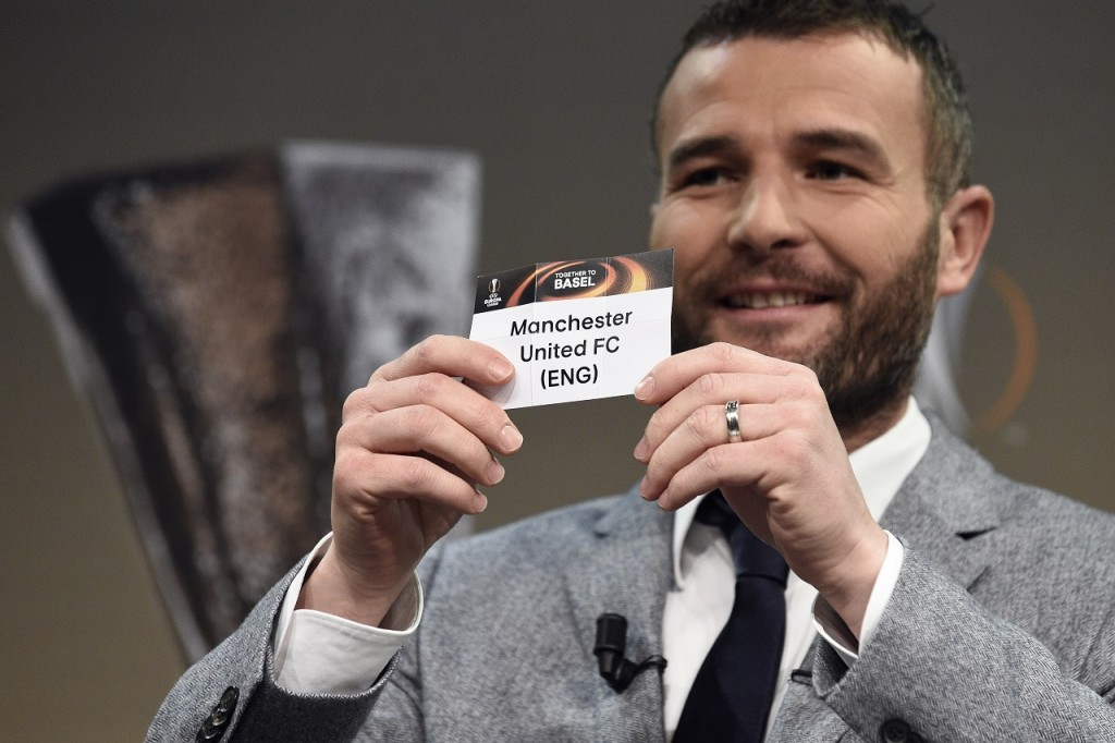 Former Swiss forward and this year's UEFA Europa League final ambassador Alexander Frei shows the name of Manchester United during the round of 16 draw of the UEFA Europa League football championship at the UEFA headquarters in Nyon on February 26, 2016. AFP PHOTO / ALAIN GROSCLAUDE / AFP / ALAIN GROSCLAUDE