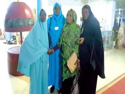 Secretary General of International Muslim Women Union (IMWU), Dr. Afaf Hussein shaking hands with Coordinator, Social Advocacy Project Hajia Sherifah Yusuf-Ajibade (left). With them are Head, Al-Mu`minaat Professional Wing Dr Monsurah Kadri (second left) and Amirah, Muslim Students' Society of Nigeria (MSSN) Lagos State Area Unit, Hajia Hafsah Badru, at the IMWU Conference in Khartoum, Sudan.