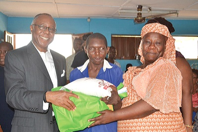 Chairman, Total Health Trust Limited, Dr. Ladi Awosika (left); a pupil of Ojuwoye Primary School Inclusive, Mushin, Sola Oyetayo; and a parent, Mrs Oluwakemi Otubanjo, during the visit of the company to the school…recently.