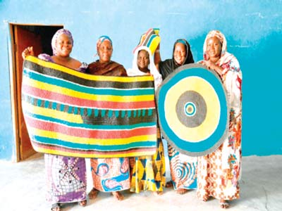 Some of the beneficiaries displaying their crafts