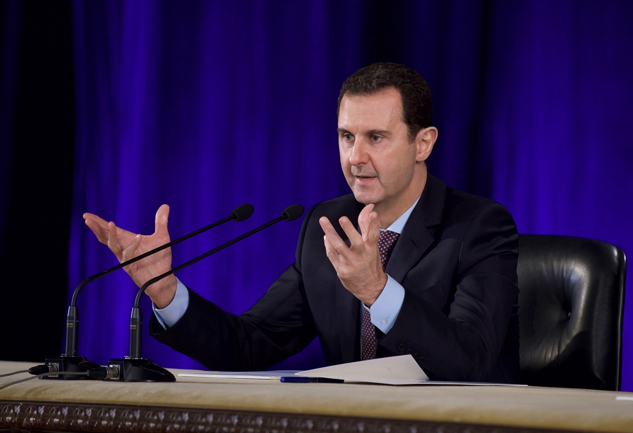 "A handout picture released by the official Syrian Arab News Agency (SANA) on February 15, 2016 shows Syrian President Bashar al-Assad meeting in Damascus members of the central Bar Association and the affiliated councils in the Syrian cities. / AFP / SANA / STRINGER /  == RESTRICTED TO EDITORIAL USE - MANDATORY CREDIT ""AFP PHOTO / HO / SANA"" - NO MARKETING NO ADVERTISING CAMPAIGNS - DISTRIBUTED AS A SERVICE TO CLIENTS =="
